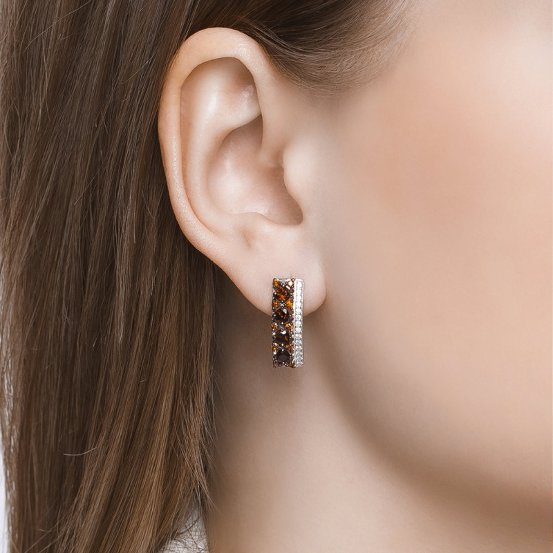 Silver earrings with red garnets and colorless cubic zirkonia